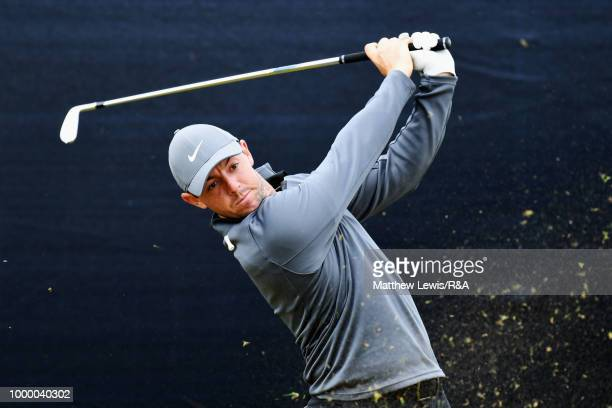 Tiger Woods of the United States collects his ball after putting on a practice round during previews ahead of the 147th Open Championship at...