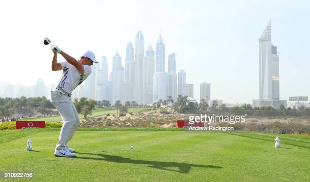 Rory McIlroy of Northern Ireland tees off on the 8th hole with the city as a backdrop during day three of Omega Dubai Desert Classic at Emirates Golf...