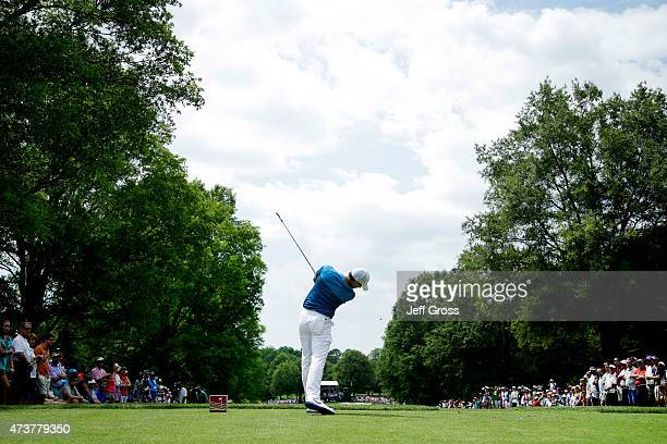 Rory McIlroy of Northern Ireland tees off on the sixth hole during the final round at the Wells Fargo Championship at Quail Hollow Club on May 17...