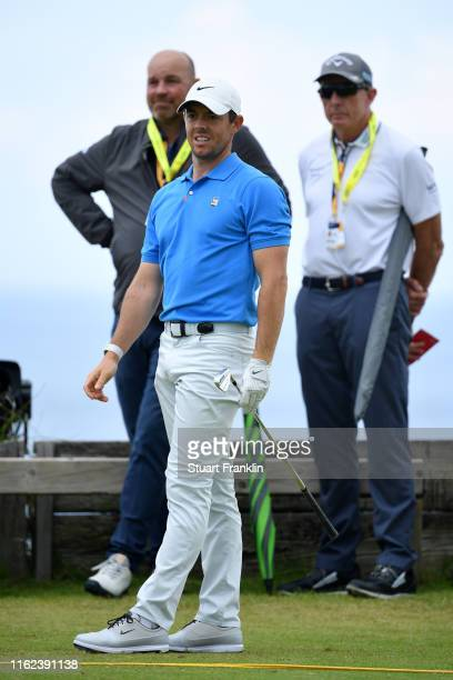 Rory McIlroy of Northern Ireland, Thomas Bjorn of Denmark and David Leadbetter look on during a practice round prior to the 148th Open Championship...