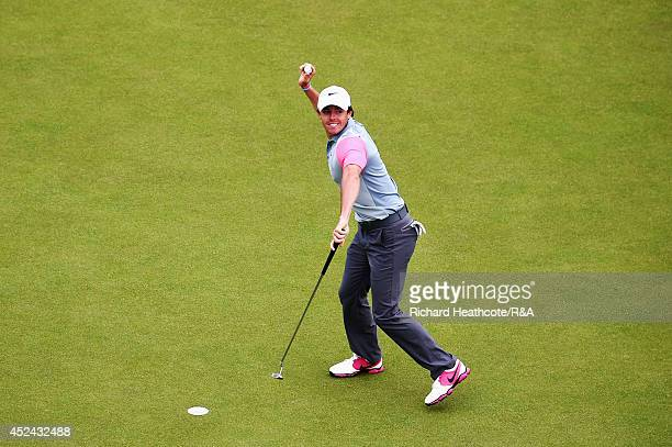 Rory McIlroy of Northern Ireland throws his ball into the crowd following his two-stroke victory on the 18th green during the final round of The...
