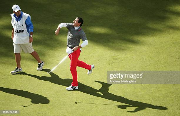 Rory McIlroy of Northern Ireland throws his ball to the crowd after holing a birdie putt on the 18th green during day four of the BMW PGA...