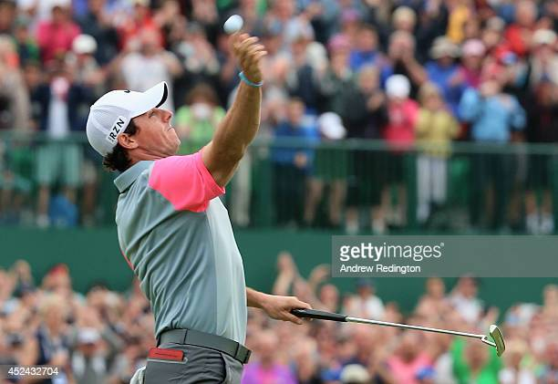 Rory McIlroy of Northern Ireland tosses his golf ball to the gallery on the 18th green after his twostroke victory at The 143rd Open Championship at...