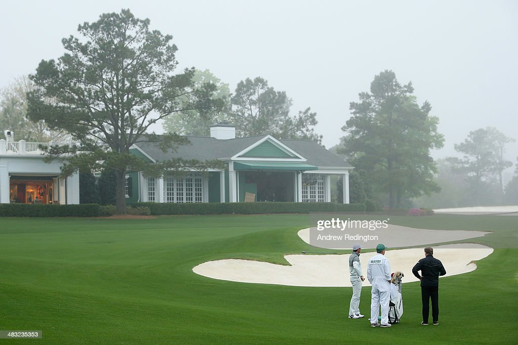 Rory McIlroy of Northern Ireland waits alongside a bunker during a practice round prior to the start of the 2014 Masters Tournament at Augusta National Golf Club on April 7, 2014 in Augusta, Georgia.