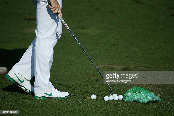 Rory McIlroy of Northern Ireland waits on the practice ground during a practice round prior to the start of the 2014 Masters Tournament at Augusta...