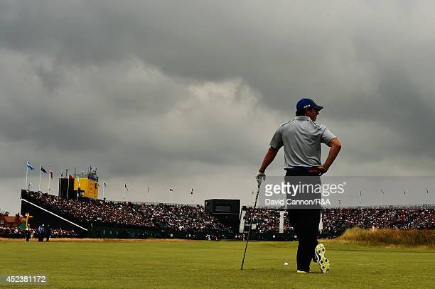 Rory McIlroy of Northern Ireland waits to play his second shot on the 18th hole during the third round of The 143rd Open Championship at Royal...
