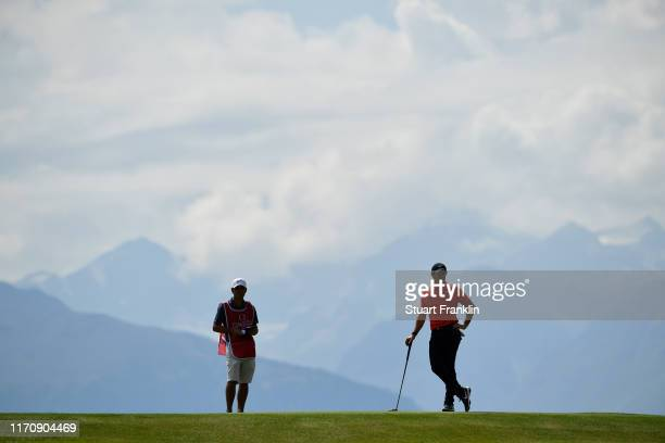 Rory McIlroy of Northern Ireland waits to put on the seventh during Day One of the Omega European Masters at Crans Montana Golf Club on August 29,...