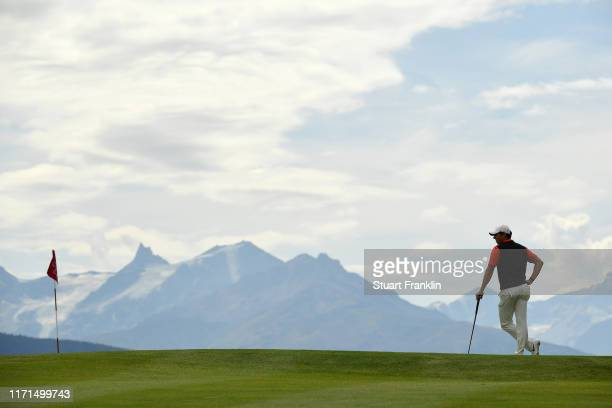 Rory McIlroy of Northern Ireland waits to put on the seventh green during Day Four of the Omega European Masters at Crans Montana Golf Club on...