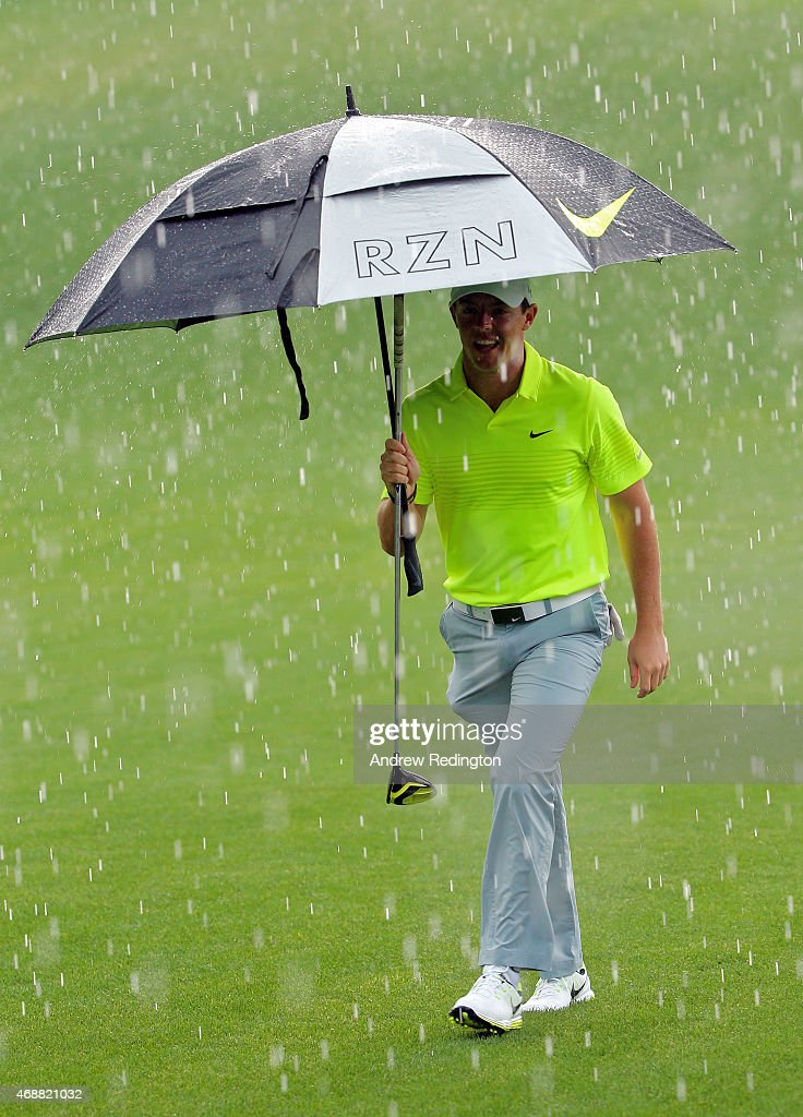 Rory McIlroy of Northern Ireland waits under an umbrella during a practice round prior to the start of the 2015 Masters Tournament at Augusta National Golf Club on April 7, 2015 in Augusta, Georgia.