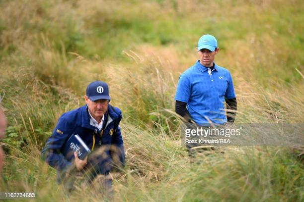 Rory McIlroy of Northern Ireland waits while rules officials officiate on the fifth hole during the first round of the 148th Open Championship held...