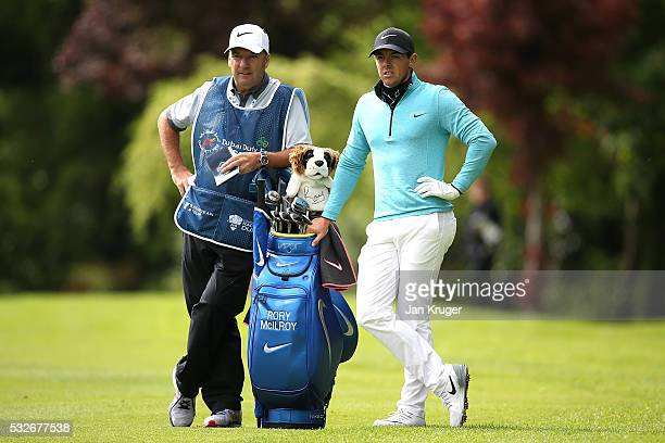 Rory McIlroy of Northern Ireland waits with caddie JP Fitzgerald on the 10th hole during the first round of the Dubai Duty Free Irish Open Hosted by...