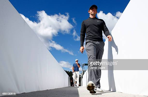 Rory McIlroy of Northern Ireland walks accross the bridge from the second green to the third tee during the Third Round of the BMW Championship at...