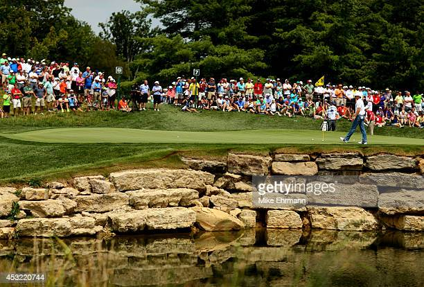 Rory McIlroy of Northern Ireland walks across the seventh green during a practice round prior to the start of the 96th PGA Championship at Valhalla...