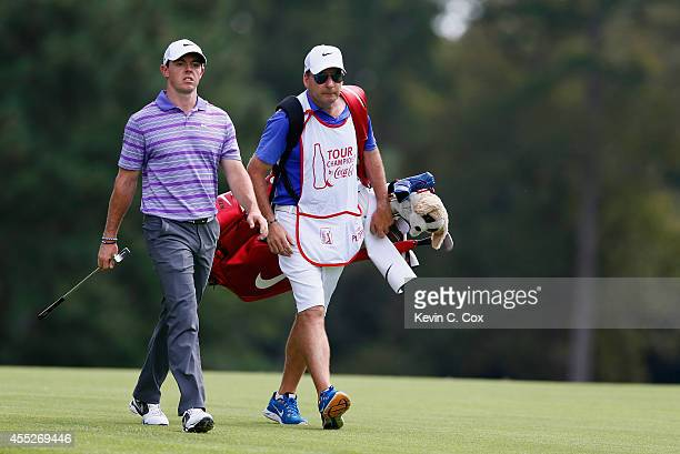 Rory McIlroy of Northern Ireland walks alongside his caddie JP Fitzgerald on the eighth hole during the first round of the TOUR Championship by...