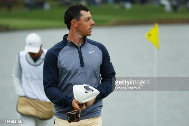 Rory McIlroy of Northern Ireland walks from the 18th green after finishing during the final round of The PLAYERS Championship on The Stadium Course...