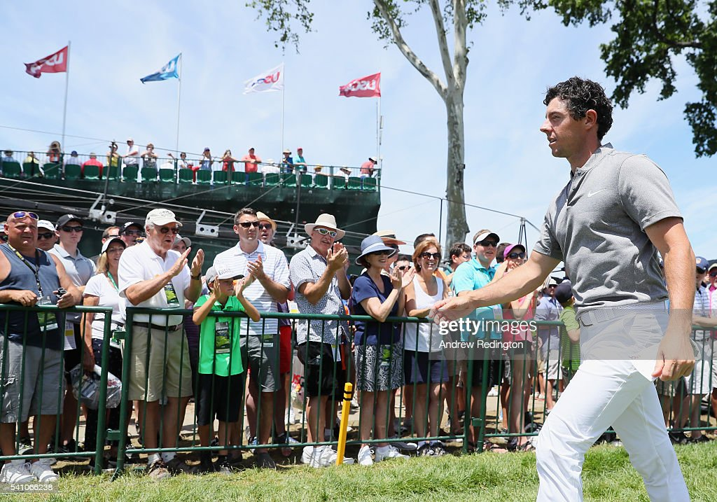 Rory McIlroy of Northern Ireland walks off the ninth green after finiishing the continuation of the second round of the U.S. Open at Oakmont Country Club on June 18, 2016 in Oakmont, Pennsylvania.
