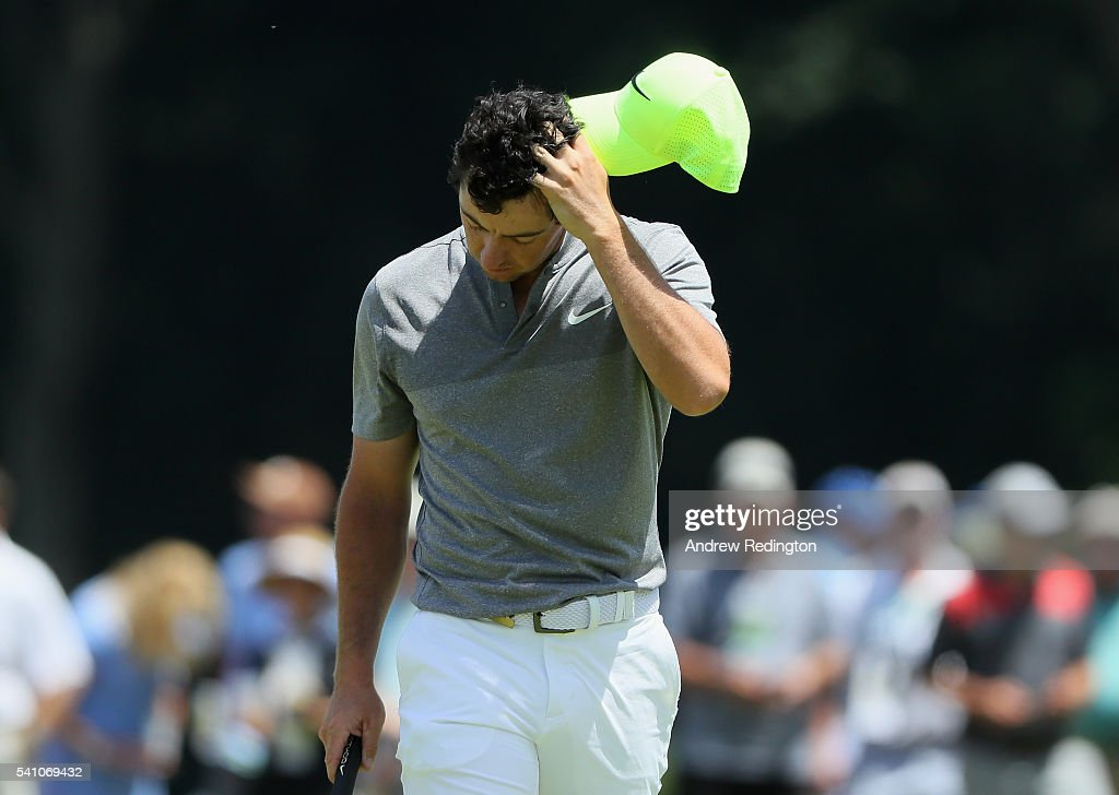 Rory McIlroy of Northern Ireland walks off the ninth green after finishing the continuation of the second round of the U.S. Open at Oakmont Country Club on June 18, 2016 in Oakmont, Pennsylvania.