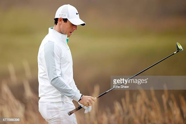 Rory McIlroy of Northern Ireland walks off the tenth tee during the first round of the 115th US Open Championship at Chambers Bay on June 18 2015 in...