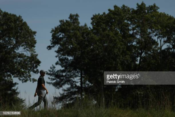 Rory McIlroy of Northern Ireland walks on the 12th hole during round three of the Dell Technologies Championship at TPC Boston on September 2, 2018...