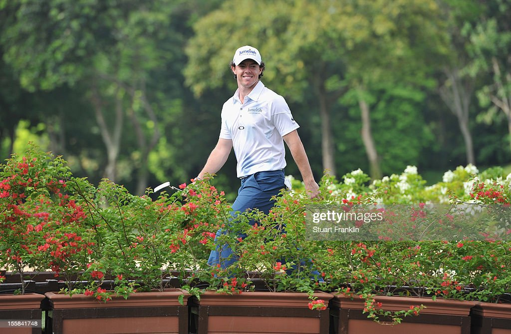 Rory McIlroy of Northern Ireland walks over a bridge during the continuation of the weather delayed first round of the Barclays Singapore Open at the Sentosa Golf Club on November 9, 2012 in Singapore.