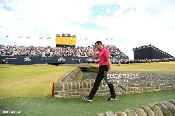 Rory McIlroy of Northern Ireland walks over bridge at the Barry Burn on the 18th hole during the final round of the Open Championship at Carnoustie...