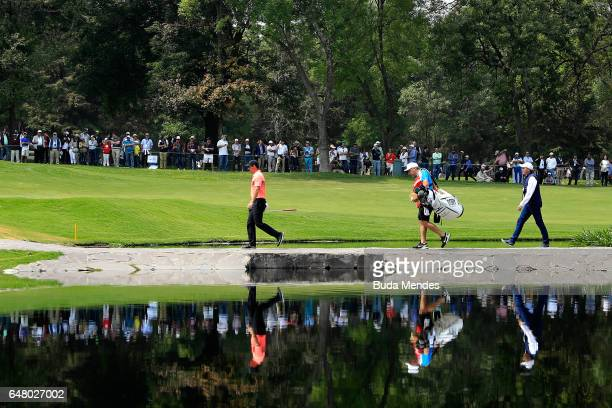 Rory McIlroy of Northern Ireland walks over the stone bridge on the sixth hole during the third round of the World Golf Championships Mexico...
