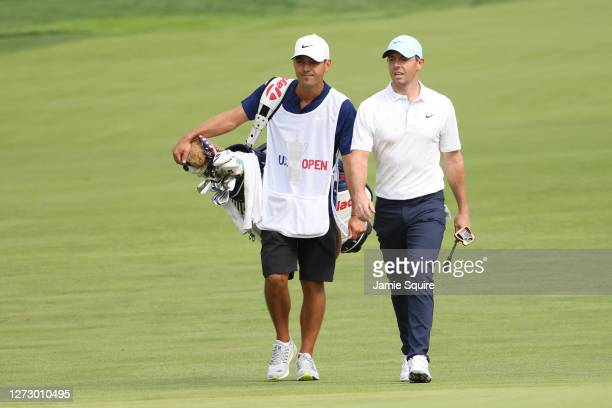 Rory McIlroy of Northern Ireland walks to the 17th green with his caddie during the first round of the 120th U.S. Open Championship on September 17,...