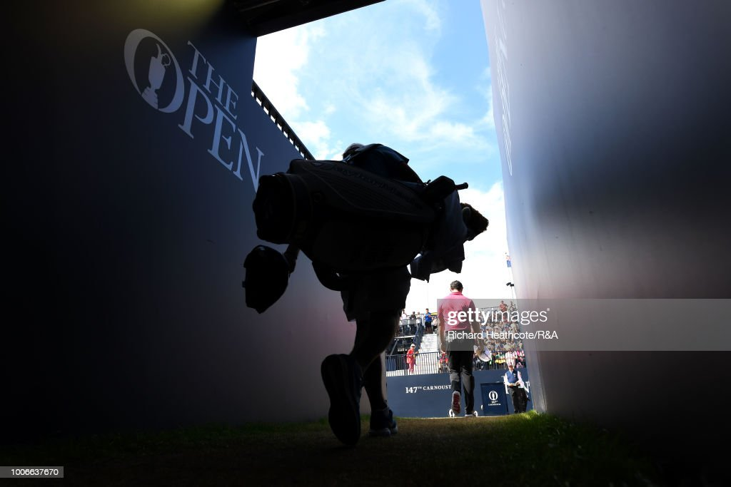 Rory McIlroy of Northern Ireland walks to the first tee with caddy Harry Diamond during the final round of the Open Championship at Carnoustie Golf Club on July 22, 2018 in Carnoustie, Scotland.