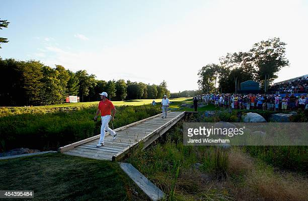 Rory McIlroy of Northern Ireland walks toward the 18th hole during the second round of the Deutsche Bank Championship at the TPC Boston on August 30,...