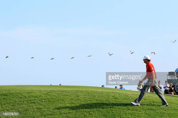 Rory McIlroy of Northern Ireland walks up to the 14th green during the Final Round of the 94th PGA Championship at the Ocean Course on August 12 2012...