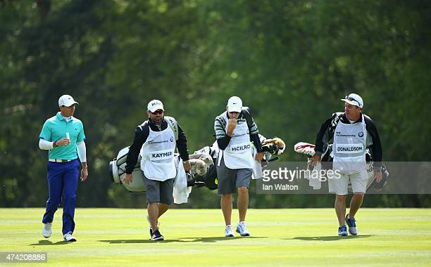 Rory McIlroy of Northern Ireland walks with caddies Craig Connelly JP Fitzgerald and Mick Donaghy during day 1 of the BMW PGA Championship at...