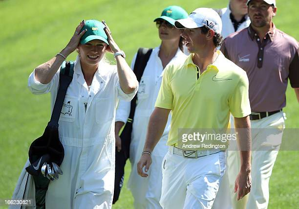 Rory McIlroy of Northern Ireland walks with his caddie Caroline Wozniacki during the Par 3 Contest prior to the start of the 2013 Masters Tournament...