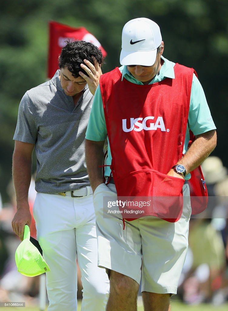 Rory McIlroy of Northern Ireland walks with his caddie J.P. Fitzgerald off the ninth green after finiishing the continuation of the second round of the U.S. Open at Oakmont Country Club on June 18, 2016 in Oakmont, Pennsylvania.