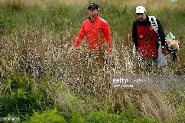 Rory McIlroy of Northern Ireland walks with his caddy JP Fitzgerald to the twelfth hole during round three of the Shell Houston Open at the Golf Club...