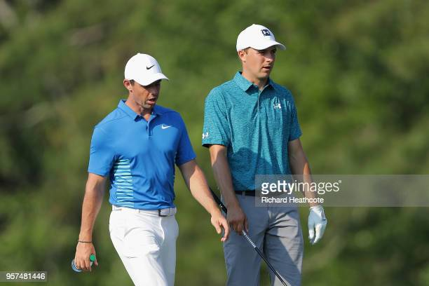 Rory McIlroy of Northern Ireland walks with Jordan Spieth of the United States during the second round of THE PLAYERS Championship on the Stadium...