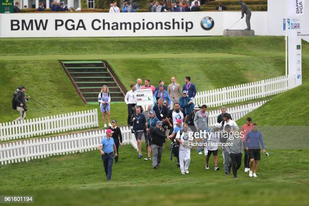 Rory Mcilroy of Northern Ireland walks with Michael Carrick Paul Scholes and Teddy Sheringham during the Pro Am for the BMW PGA Championship at...
