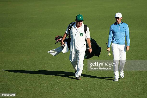 Rory McIlroy of Northern Ireland walks with Michael Mick Donaghy caddie for Jamie Donaldson of Wales during a practice round prior to the start of...