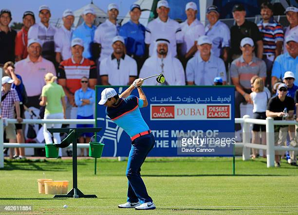 Rory McIlroy of Northern Ireland warming up on the driving range before he teed off in the final round of the 2015 Omega Dubai Desert Classic on the...