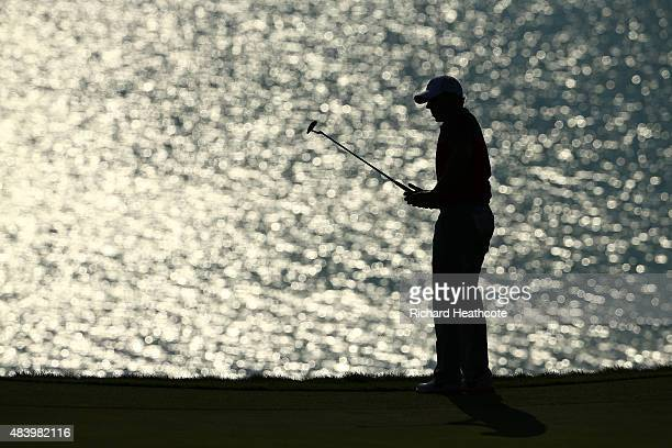 Rory McIlroy of Northern Ireland watches a putt on the 12th green during the second round of the 2015 PGA Championship at Whistling Straits on August...