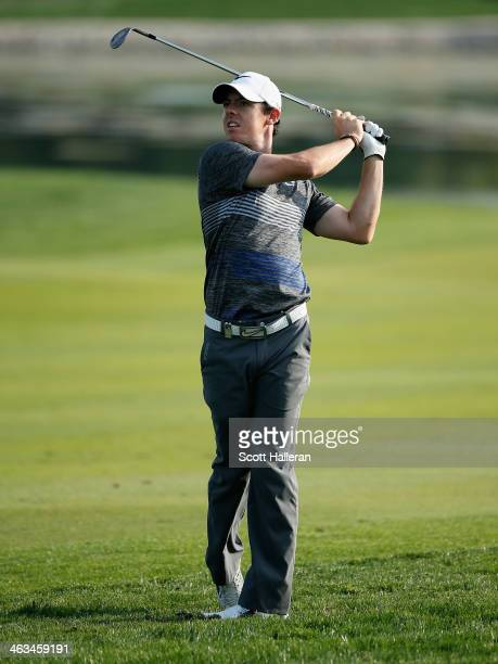 Rory McIlroy of Northern Ireland watches his approach shot on the 17th hole during the third round of the Abu Dhabi HSBC Golf Championship at the Abu...