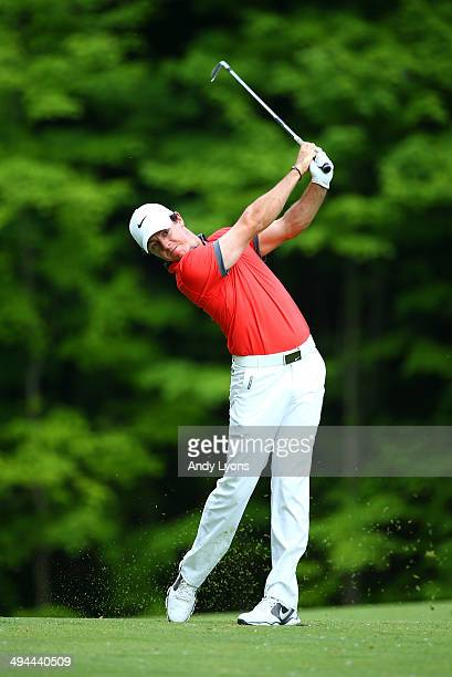 Rory McIlroy of Northern Ireland watches his second shot on the 15th hole during the first round of the Memorial Tournament presented by Nationwide...