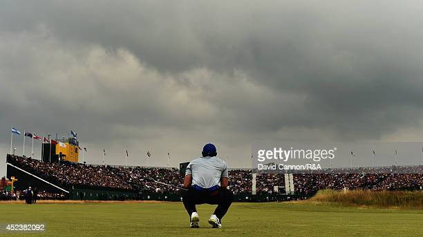 Rory McIlroy of Northern Ireland watches his second shot on the 18th hole during the third round of The 143rd Open Championship at Royal Liverpool on...