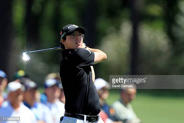 Rory McIlroy of Northern Ireland watches his tee shot on the 12th hole during the first round of the 2011 Masters Tournament at Augusta National Golf...