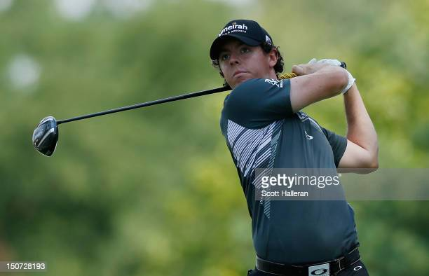 Rory McIlroy of Northern Ireland watches his tee shot on the 13th hole during the third round of The Barclays at the Black Course at Bethpage State...