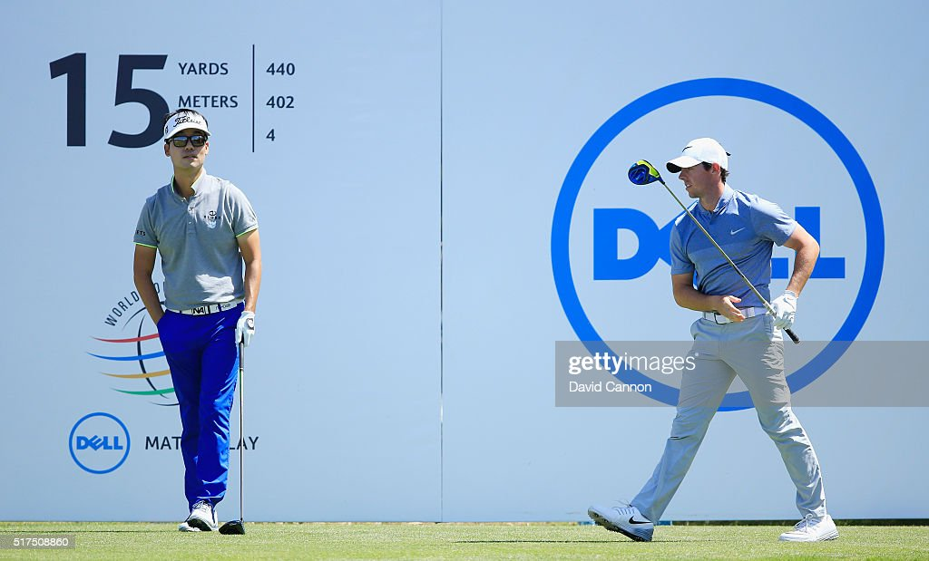 Rory McIlroy of Northern Ireland (R) watches his tee shot on the 15th hole as Kevin Na of the United States looks on during the third round of the World Golf Championships-Dell Match Play at the Austin Country Club on March 25, 2016 in Austin, Texas.