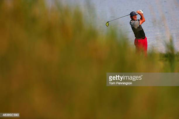 Rory McIlroy of Northern Ireland watches his tee shot on the 18th hole during the first round of the 2015 PGA Championship at Whistling Straits on...