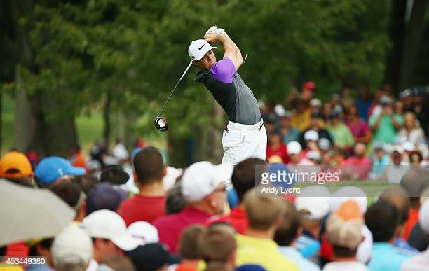 Rory McIlroy of Northern Ireland watches his tee shot on the fifth hole during the final round of the 96th PGA Championship at Valhalla Golf Club on...