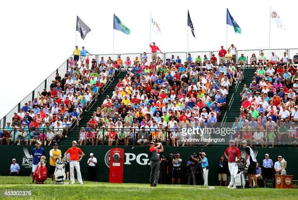Rory McIlroy of Northern Ireland watches his tee shot on the first hole during the first round of the 96th PGA Championship at Valhalla Golf Club on...