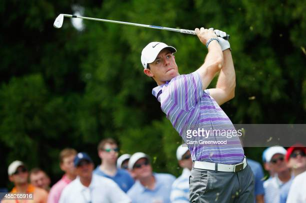 Rory McIlroy of Northern Ireland watches his tee shot on the second hole during the first round of the TOUR Championship by Coca-Cola at the East...