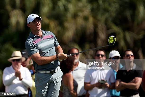 Rory McIlroy of Northern Ireland watches his tee shot on the seventh hole during the second round of the World Golf Championships-Cadillac...